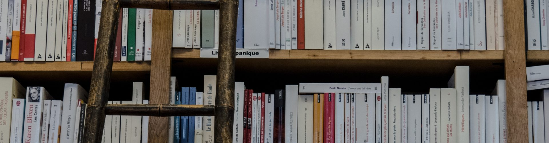 a close up of a book shelf filled with books